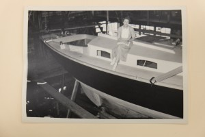 Mrs. James Moffett sitting on the cabin top of her new competition. Guess who won? Credit MOHAI